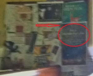 "I know its a ridiculous blurry photo-but the circled poster says, ""It's a wonderful life""."